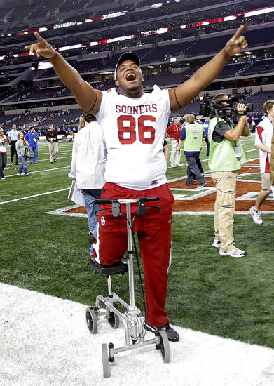 Oklahoma's Adrian Taylor celebrates the 23-20 win over Nebraska during the Big 12 football championship game between the University of Oklahoma Sooners (OU) and the University of Nebraska Cornhuskers (NU) at Cowboys Stadium on Saturday, Dec. 4, 2010, in Arlington, Texas.  Photo by Chris Landsberger, The Oklahoman