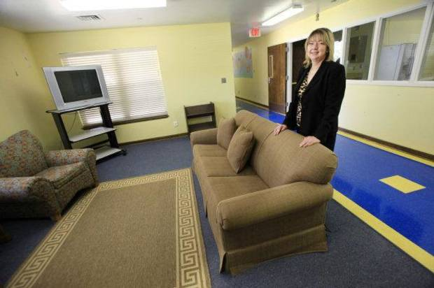 Debbie Clour shows the reception area of the new Building Bridges Visitation Center to be opened in Oklahoma City. The center is designed to give parents and children in foster care a more homelike place to meet. PHOTO BY PAUL B. SOUTHERLAND, THE OKLAHOMAN <strong>PAUL B. SOUTHERLAND - PAUL B. SOUTHERLAND</strong>