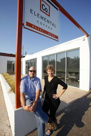 J.D. Merryweather, partner in Coop Ale Works, and Laura Massenat, co-owner of Elemental Coffee, out front of Elemental Coffee, 815 N. Hudson, in Oklahoma City Thursday, Aug. 25, 2011. Photo by Paul B. Southerland, The Oklahoman ORG XMIT: KOD