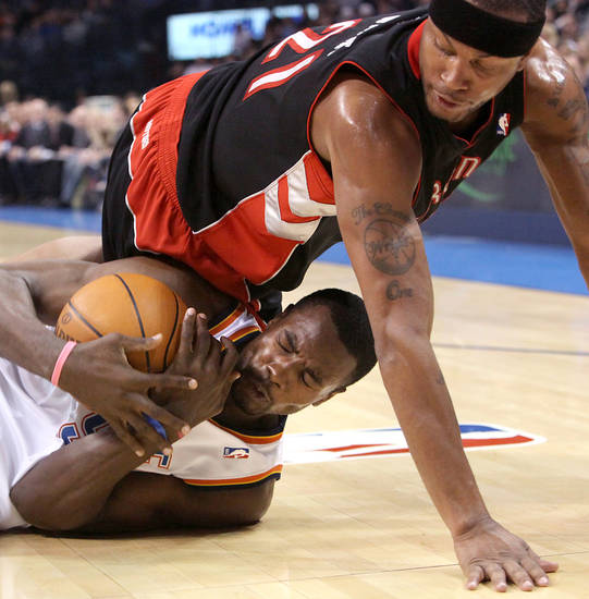 Oklahoma City's Serge Ibaka gets a loose ball despite pressure from Toronto's Antoine Wright during their NBA basketball game at the Ford Center in Oklahoma City on Sunday, Feb. 28, 2010. Photo by John Clanton, The Oklahoman
