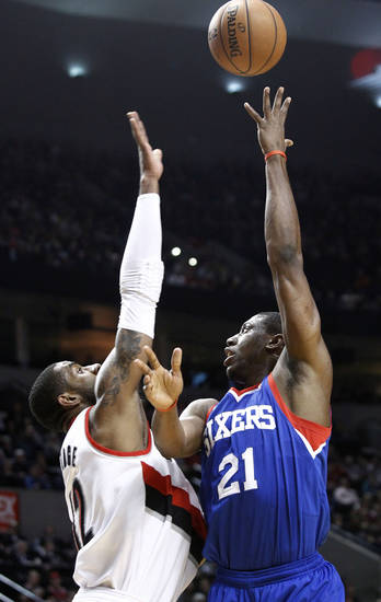 Philadelphia 76ers forward Thaddeus Young, right, shoots over Portland Trail Blazers forward LaMarcus Aldridge during the first quarter of an NBA basketball game in Portland, Ore., Saturday, Dec. 29, 2012.(AP Photo/Don Ryan)