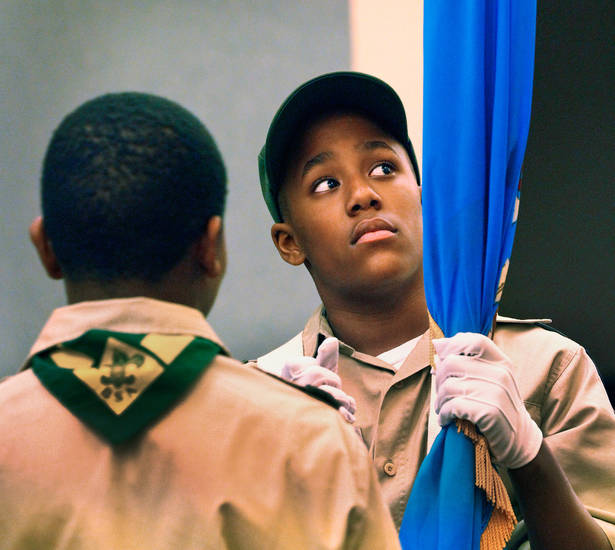 Joshua Heard, 11, readies the Oklahoma flag before  he and other Boy Scouts from Troop 1864, sponsored by St, John Missionary Baptist Church,  presented the colors at the opening ceremony for this year's Midwest City Martin Luther King, Jr. prayer breakfast in the Reed Center; it is one of several events in the Oklahoma City area that allowed local residents to observe the national holiday honoring slain civil rights leader, Dr. Rev. Martin Luther King, Jr. on Monday, Jan. 16,  2012,    Photo by Jim Beckel, The Oklahoman