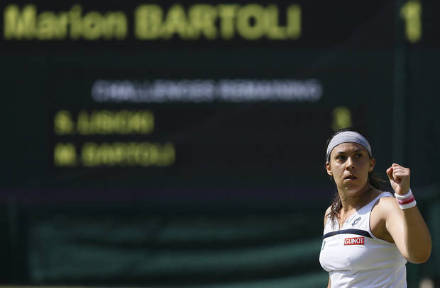 Marion Bartoli of France reacts after winning a point against Sabine Lisicki of Germany during their Women's singles final match at the All England Lawn Tennis Championships in Wimbledon, London, Saturday, July 6, 2013. (AP Photo/Kirsty Wigglesworth)