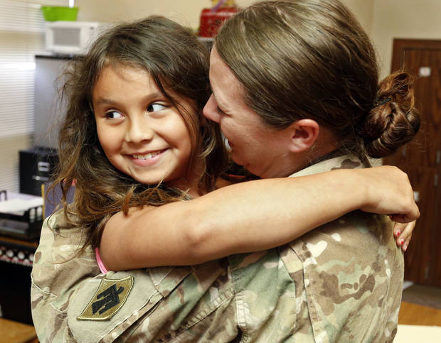 "Army Spc. Jari ""J.J."" Murphy hugs her daughter Seneca, 8, after reuniting with her at Truman Primary School in Norman. Murphy just returned from spending nearly a year in Afghanistan. PHOTO BY STEVE SISNEY, THE OKLAHOMAN <strong>STEVE SISNEY</strong>"