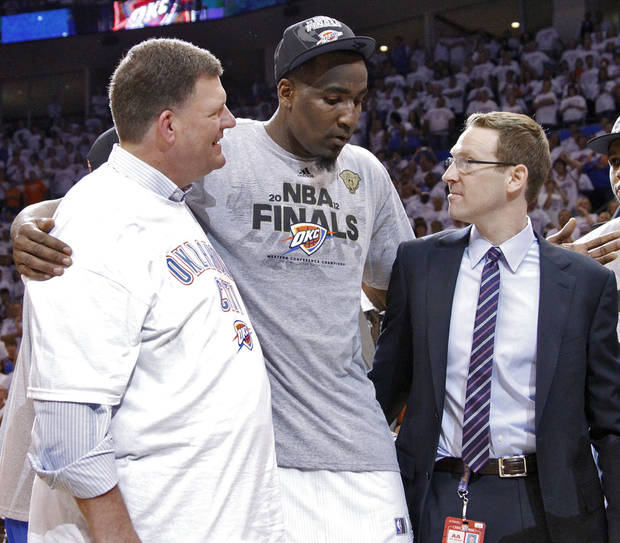 Oklahoma City Thunder chairman Clay Bennett and general manager Sam Presti talk with Kendrick Perkins as they celebrate after the Thunder's 107-99 win over the Spurs in Game 6 of the Western Conference Finals between the Oklahoma City Thunder and the San Antonio Spurs in the NBA playoffs at the Chesapeake Energy Arena in Oklahoma City, Wednesday, June 6, 2012. Photo by Chris Landsberger, The Oklahoman