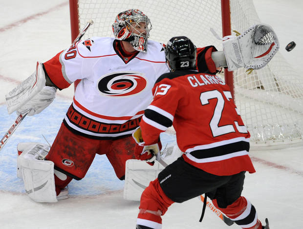 Carolina Hurricanes goaltender Cam Ward cannot reach the puck as New Jersey Devils' David Clarkson (23) skates in during the first period of an NHL hockey game Tuesday, Feb. 12, 2013, in Newark, N.J. (AP Photo/Bill Kostroun)