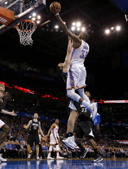 Oklahoma City's Kevin Durant (35) goes to the basket over Minnesota's Nikola Pekovic (14) during an NBA basketball game between the Oklahoma City Thunder and the Minnesota Timberwolves at Chesapeake Energy Arena in Oklahoma City, Wednesday, Jan. 9, 2013.  Photo by Bryan Terry, The Oklahoman
