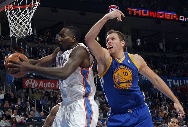 Oklahoma City 's Kendrick Perkins (5) takes a rebound from Golden State's David Lee (10) during an NBA basketball game between the Oklahoma City Thunder and the Golden State Warriors at Chesapeake Energy Arena in Oklahoma City, Sunday, Nov. 18, 2012.  Photo by Garett Fisbeck, The Oklahoman