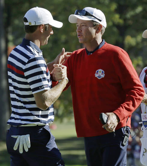 USA's captain Davis Love III congratulates Dustin Johnson after his singles match win over Europe's Nicolas Colsaerts at the Ryder Cup PGA golf tournament Sunday, Sept. 30, 2012, at the Medinah Country Club in Medinah, Ill. (AP Photo/David J. Phillip)  ORG XMIT: PGA164