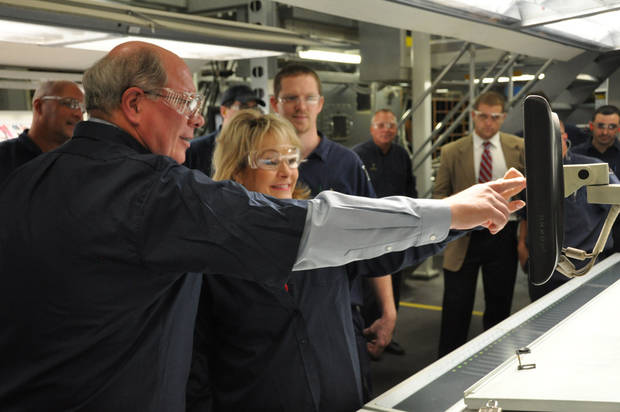 Gov. Mary Fallin assists with starting up the new press at Quad/Graphics' Oklahoma City plant. Photo provided <strong></strong>