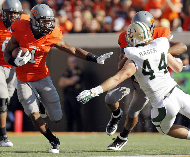 OSU&#039;s Joseph Randle (1) carries the ball as Tracy Moore (87) blocks Bryce Hager (44) of Baylor in the second quarter during a college football game between the Oklahoma State University Cowboys (OSU) and the Baylor University Bears (BU) at Boone Pickens Stadium in Stillwater, Okla., Saturday, Oct. 29, 2011. Photo by Nate Billings, The Oklahoman