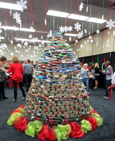 A Christmas tree created out of books in the Mistletoe Market entryway, represents the Junior League�s literacy efforts. (Photo by Helen Ford Wallace).