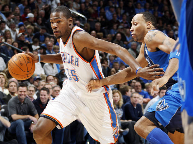 Oklahoma City's Kevin Durant (35) drives the ball past Shawn Marion (0) of Dallas in the first half during an NBA basketball game between the Oklahoma City Thunder and the Dallas Mavericks at Chesapeake Energy Arena in Oklahoma City, Thursday, Dec. 29, 2011. Photo by Nate Billings, The Oklahoman