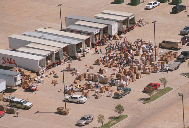 Aerial view: Donated relief supplies for tornado victims being organized in the parking lot of the First Baptist Church in Moore.