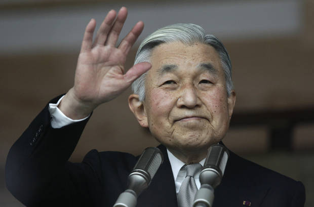 Japan's Emperor Akihito waves to a crowd of well-wishers through the bulletproof glass of a balcony, during a morning appearance to mark his 79th birthday,  at the Imperial Palace in Tokyo Sunday, Dec. 23, 2012.  (AP Photo/Shizuo Kambayashi)