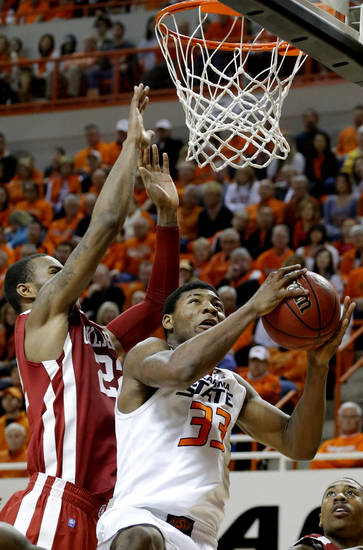 Oklahoma State's Marcus Smart (33) shoots as Oklahoma's Amath M'Baye (22) defends during the Bedlam men's college basketball game between the Oklahoma State University Cowboys and the University of Oklahoma Sooners at Gallagher-Iba Arena in Stillwater, Okla., Saturday, Feb. 16, 2013. Photo by Sarah Phipps, The Oklahoman