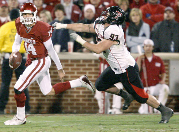 OU's Sam Bradford runs past Colby Whitlock of Texas Tech during the college football game between the University of Oklahoma Sooners and Texas Tech University at Gaylord Family -- Oklahoma Memorial Stadium in Norman, Okla., Saturday, Nov. 22, 2008. BY BRYAN TERRY, THE OKLAHOMAN