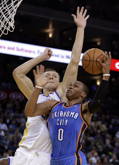 Oklahoma City Thunder's Russell Westbrook (0) shoots against Golden State Warriors' Andris Biedrins during the first half of an NBA basketball game, Wednesday, Jan. 23, 2013, in Oakland, Calif. (AP Photo/Ben Margot)