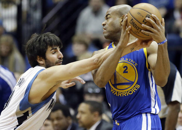 Minnesota Timberwolves' Ricky Rubio of Spain, left, tries to knock the ball away from Golden State Warriors' Jarrett Jack in the first quarter of an NBA basketball game Sunday, Feb. 24, 2013, in Minneapolis. (AP Photo/Jim Mone)