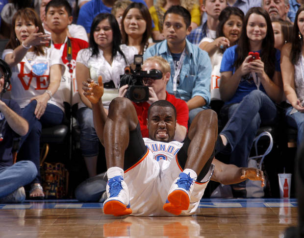 Oklahoma City's Serge Ibaka gets up after a fall during the NBA basketball game between the Oklahoma City Thunder and the Denver Nuggets at Chesapeake Energy Arena in Oklahoma City, Wednesday, April 25, 2012. Oklahoma City lost 106-101. Photo by Bryan Terry, The Oklahoman