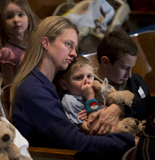 Residents wait for the start of an interfaith vigil for the victims of the Sandy Hook Elementary School shooting on Sunday, Dec. 16, 2012 at Newtown High School in Newtown, Conn. A gunman walked into Sandy Hook Elementary School Friday and opened fire, killing 26 people, including 20 children. (AP Photo/Evan Vucci) ORG XMIT: CTEV111