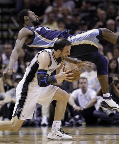 Memphis Grizzlies' Tony Allen, top, flips over San Antonio Spurs' Manu Ginobili, of Argentina, during the second quarter of Game 2 of a first-round NBA basketball playoff series, Wednesday, April 20, 2011, in San Antonio. (AP Photo/Eric Gay) ORG XMIT: TXEG106