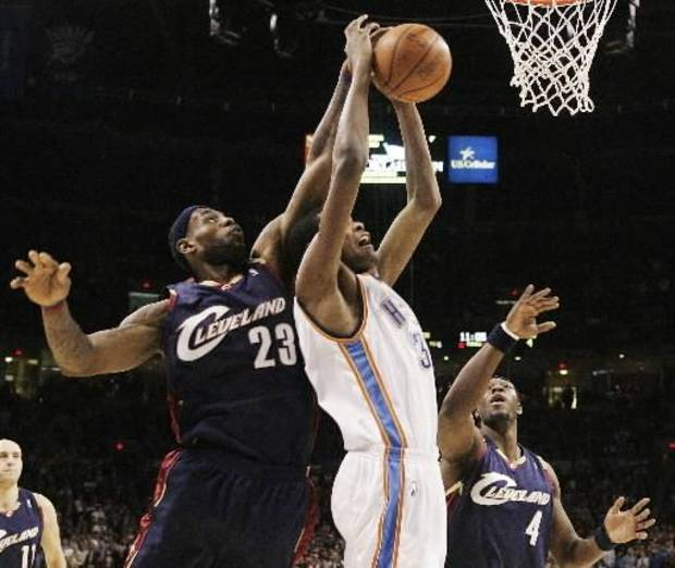 Oklahoma City  Thunder guard Kevin Durant, center, has the ball knocked away by Cleveland Cavaliers forward LeBron James, left, as he attempts to shoot between James and forward Ben Wallace, right, in the first quarter of an NBA basketball game in Oklahoma City, Sunday, Dec. 21, 2008. Durant had 26 points for the  Thunder, but Cleveland won 102-91. (AP Photo/Sue Ogrocki)