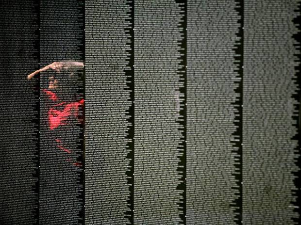 Mary Morse, of Shawnee, is reflected in The Moving Wall exhibit, as she look at the memorial, a replica of Vietnam Veterans Memorial in Washington DC, at  Woodland Park in Shawnee , Okla., on Sunday, August 23, 2009. By John Clanton, The Oklahoman ORG XMIT: KOD