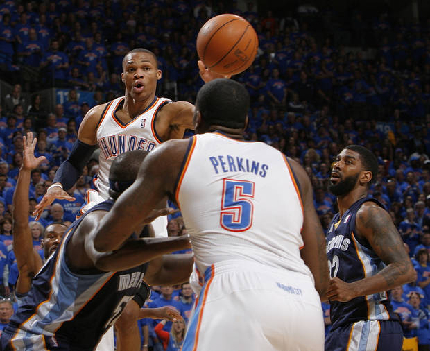 Oklahoma City's Russell Westbrook (0) passes the ball near O.J. Mayo (32), right, of Memphis as Oklahoma City's Kendrick Perkins (5) is guarded by Zach Randolph (50) of Memphis in the first half during game 7 of the NBA basketball Western Conference semifinals between the Memphis Grizzlies and the Oklahoma City Thunder at the OKC Arena in Oklahoma City, Sunday, May 15, 2011. Photo by Nate Billings, The Oklahoman