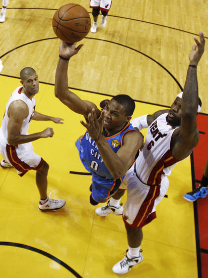Oklahoma City Thunder point guard Russell Westbrook shoots as Miami Heat small forward Shane Battier (31) and LeBron James (6) defend during the first half at Game 3 of the NBA Finals basketball series, Sunday, June 17, 2012, in Miami. (AP Photo/Mike Ehrmann, Pool) ORG XMIT: NBA128