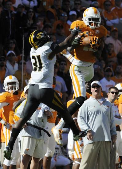 Tennessee wide receiver Justin Hunter (11) makes a catch over Missouri defensive back E.J. Gaines (31) during the first quarter during an NCAA football game at Neyland Stadium, Saturday, Nov. 10, 2012, in Knoxville, Tenn. (AP Photo/Knoxville News Sentinel, Amy Smotherman Burgess)