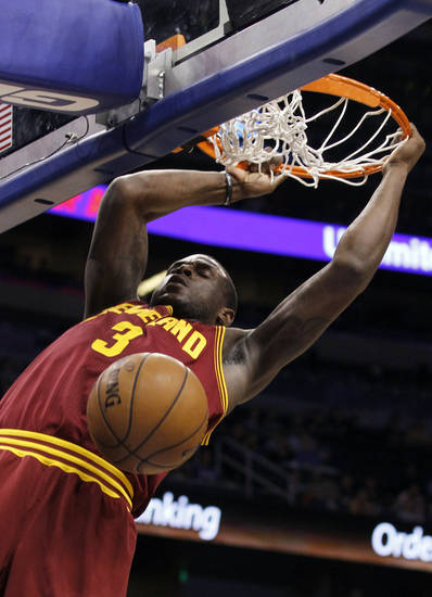 Cleveland Cavaliers guard Dion Waiters (3) dunks the ball during the first half of an NBA basketball game against the Orlando Magic in Orlando, Fla., on Saturday, Feb. 23, 2013. (AP Photo/Reinhold Matay)