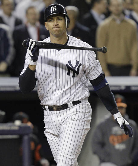 New York Yankees' Alex Rodriguez strikes out during the eighth inning of Game 4 of the American League division baseball series against the Baltimore Orioles, Thursday, Oct. 11, 2012, in New York. (AP Photo/Kathy Willens)