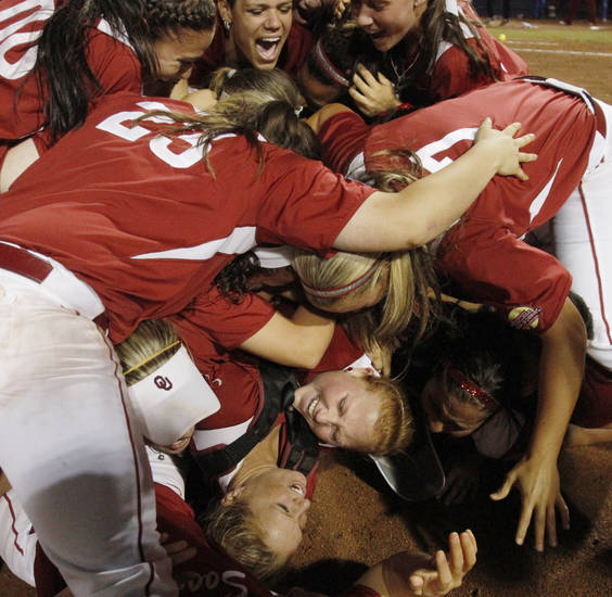 Oklahoma players piled on top of one another on the field after winning the WCWS Final for the NCAA Championship by defeatingTennessee 4-0 on June 4, 2013. Photo by KT KING, The Oklahoman
