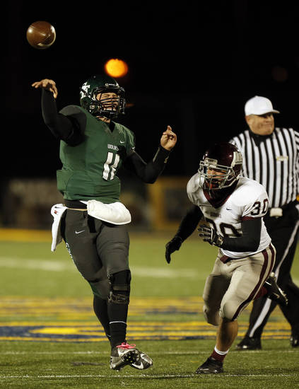 Santa Fe's Justice Hansen (11) throws the ball during a high school football game between Edmond Memorial and Edmond Santa Fe at Wantland Stadium in Edmond, Okla., Friday, Oct. 26, 2012.  Photo by Garett Fisbeck, The Oklahoman