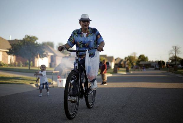 Osei Bandele, Vice President of the JFK Neighborhood Association, rides his bike during a National Night Out event at the JFK Neighborhood in Oklahoma City, Tuesday, Sept. 11, 2012.  Photo by Garett Fisbeck, The Oklahoman
