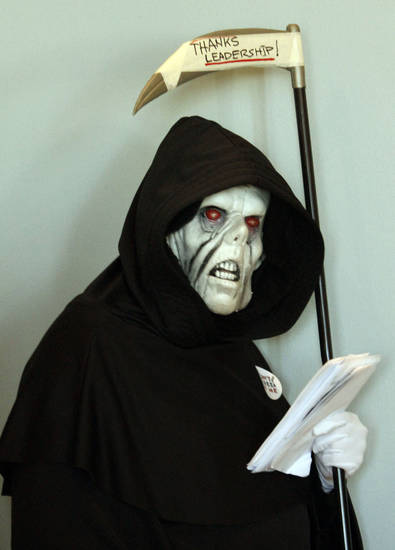 "The ""Grim Reaper"" attends Governor Mary Fallin's announcement  for plans to put tobacco regulations aimed at reducing second hand smoke to a vote of the people at the State Capitol in Oklahoma City, Tuesday February  19, 2013. Photo By Steve Gooch, The Oklahoman"