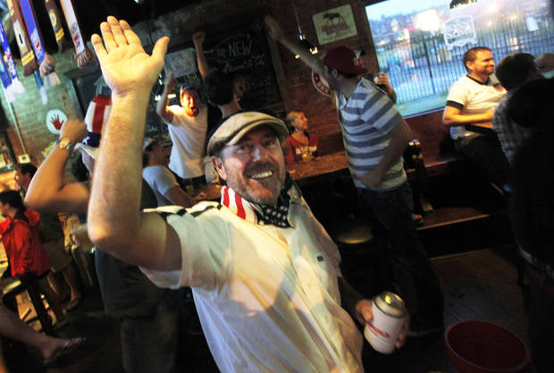 Alex Hyams, from England but turned a United States fan, goes for a high five after the United States scores to defeat Costa Rica in a match watched by the American OUtlaws at Skinny Slim's Public House in Bricktown on July 16, 2013. Photo by K.T. King