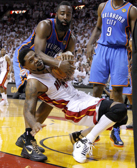 Oklahoma City's James Harden (13) fights for the ball with Miami's Udonis Haslem (40) during Game 4 of the NBA Finals between the Oklahoma City Thunder and the Miami Heat at American Airlines Arena, Tuesday, June 19, 2012. Oklahoma City lost 104-98.  Photo by Bryan Terry, The Oklahoman