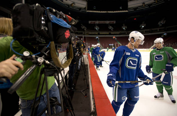 Vancouver Canucks'  Henrik Sedin, left, of Sweden, and Jannik Hansen, of Denmark, are shown during NHL hockey training camp at Rogers Arena in Vancouver, British Columbia, Tuesday, Jan. , 15, 2013. (AP Photo/The Canadian Press, Jonathan Hayward)