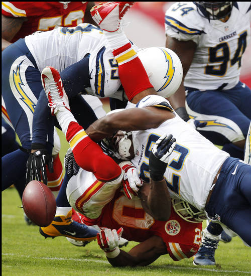 Kansas City Chiefs running back Shaun Draughn (20) fumbles as he is hit by San Diego Chargers defensive back Shareece Wright (29) during the second half of an NFL football game at Arrowhead Stadium in Kansas City, Mo., Sunday, Sept. 30, 2012. The Chargers defeated the Chiefs 37-20. (AP Photo/Ed Zurga)