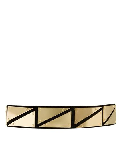 For a similar look as actress Leelee Sobieski donned at Paris Fashion Week, try the Asos triangle metal plate detail waist belt from Asos.com for $26.39, (Courtesy Asos.com via Los Angeles Times/MCT)