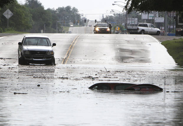 A car is submerged in floodwaters between Sooner Rd. and Air Depot Blvd. on NE 23rd St. in Midwest City, OK, Saturday, June 1, 2013, after up to eight inches of rain fell during the previous 24 hours. Photo by Paul Hellstern, The Oklahoman
