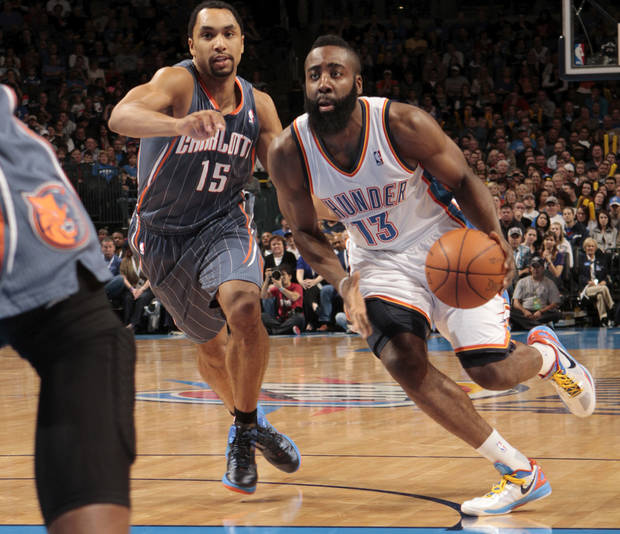Oklahoma City Thunder's James Harden (13) drives past Charlotte Bobcats' Gerald Henderson (15) during the NBA basketball game between the Oklahoma City Thunder and the Charlotte Bobcats at Chesapeake Energy Arena in Oklahoma City, Saturday, March 10, 2012. Photo by Steve Sisney, The Oklahoman