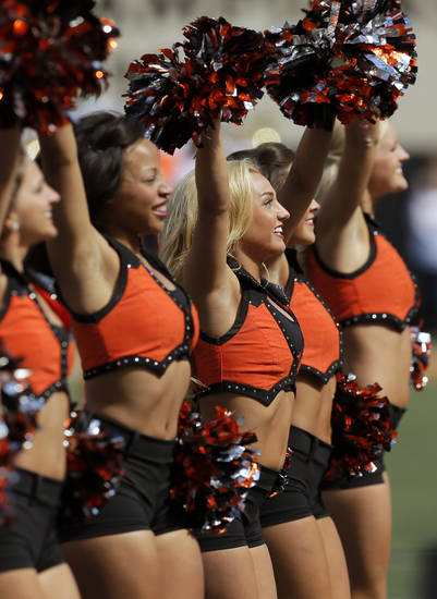 The OSU pom squad dances before a college football game between the Oklahoma State University Cowboys (OSU) and the Kansas State University Wildcats (KSU) at Boone Pickens Stadium in Stillwater, Okla., Saturday, Oct. 5, 2013. Photo by Nate Billings, The Oklahoman