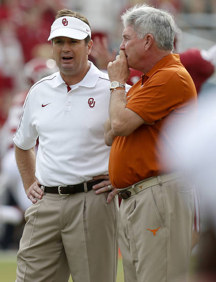 Oklahoma Coach Bob Stoops, left, and Texas coach Mack Brown meet before the Red River Rivalry college football game between the University of Oklahoma (OU) and the University of Texas (UT) at the Cotton Bowl in Dallas, Saturday, Oct. 13, 2012. Photo by Bryan Terry, The Oklahoman