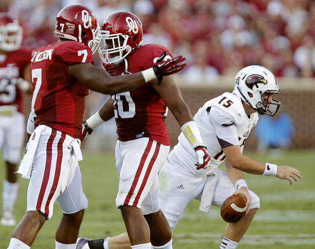 OU�s Corey Nelson, left, and Frank Shannon react after a stop on Louisiana-Monroe quarterback Kolton Browning during the Sooners� 34-0 season-opening win on Saturday. Photo by Chris Landsberger, The Oklahoman