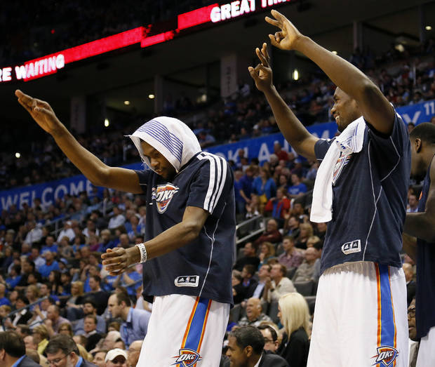 Oklahoma City's Kevin Durant (35) and Serge Ibaka (9) celebrate from the bench after a 3-point shot in the fourth quarter during an NBA basketball game between the Oklahoma City Thunder and the Dallas Mavericks at Chesapeake Energy Arena in Oklahoma City, Monday, Feb. 4, 2013. The Thunder won. 112-91. Photo by Nate Billings, The Oklahoman