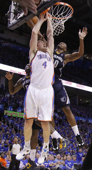 Oklahoma City's Nick Collison (4) battles under the basket with Darrell Arthur (00) of Memphis during game two of the Western Conference semifinals between the Memphis Grizzlies and the Oklahoma City Thunder in the NBA basketball playoffs at Oklahoma City Arena in Oklahoma City, Tuesday, May 3, 2011. Photo by Chris Landsberger, The Oklahoman