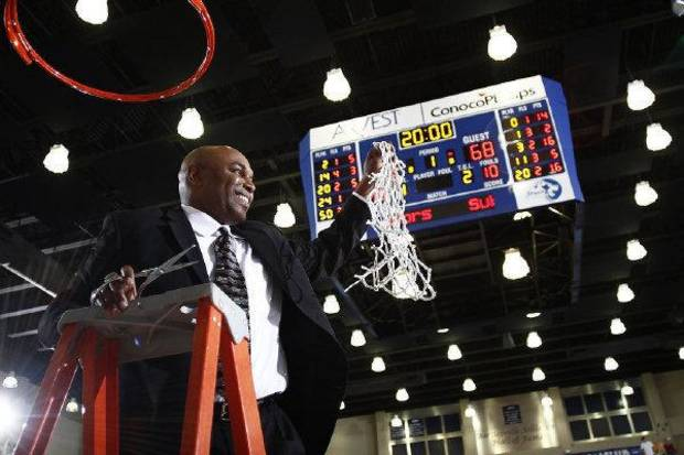 UCO basketball coach Terry Evans cuts down the net after the Bronchos won the Lone Star Conference Tournament. Evans met with the University of Oklahoma regarding its coaching vacancy earlier this week. PHOTO PROVIDED <strong>PROVIDED</strong>